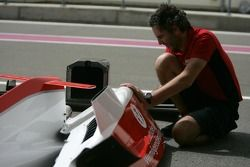 An ART Grand Prix mechanic at work