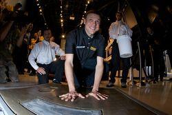 Champion's breakfast: Matt Kenseth, Roush Fenway Racing Ford, has his hands imprint on the Daytona 500 champion cement plate