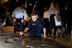 Champion's breakfast: Matt Kenseth, Roush Fenway Racing Ford, signs his Daytona 500 champion cement plate