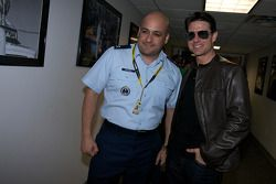 Actor Tom Cruise poses with a crew member