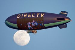 The DirectTV blimp crosses the moon