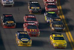 Clint Bowyer, Richard Childress Racing Chevrolet and Michael Waltrip, Michael Waltrip Racing Toyota lead a group of cars
