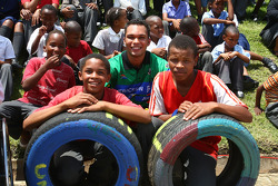 Adrian Zaugg, driver of A1 Team South Africa visit a Soweto school