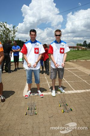 Neel Jani, driver of A1 Team Switzerland and Alexandre Imperatori, driver of A1 Team Switzerland visit a Soweto school