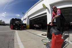 The Office Depot crew waits for Tony Stewart to enter the garage