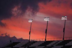 The sun sets on the Daytona International Speedway