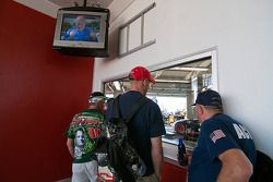 Fans watch their favorite drivers and teams work