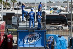 The Miller Lite Crew watch their car take the track