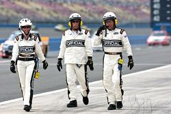 Officials walk down pit road before the race