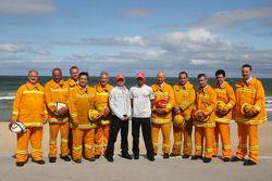 Heikki Kovalainen, McLaren Mercedes, Lewis Hamilton, McLaren Mercedes with firemen