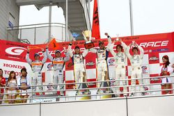 GT500 podium: class and overall winners Joao Paulo Lima De Oliveira and Seiji Ara, second place Ryo
