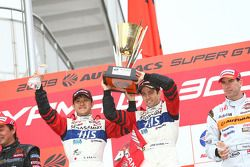 GT500 podium: class and overall winners Joao Paulo Lima De Oliveira and Seiji Ara