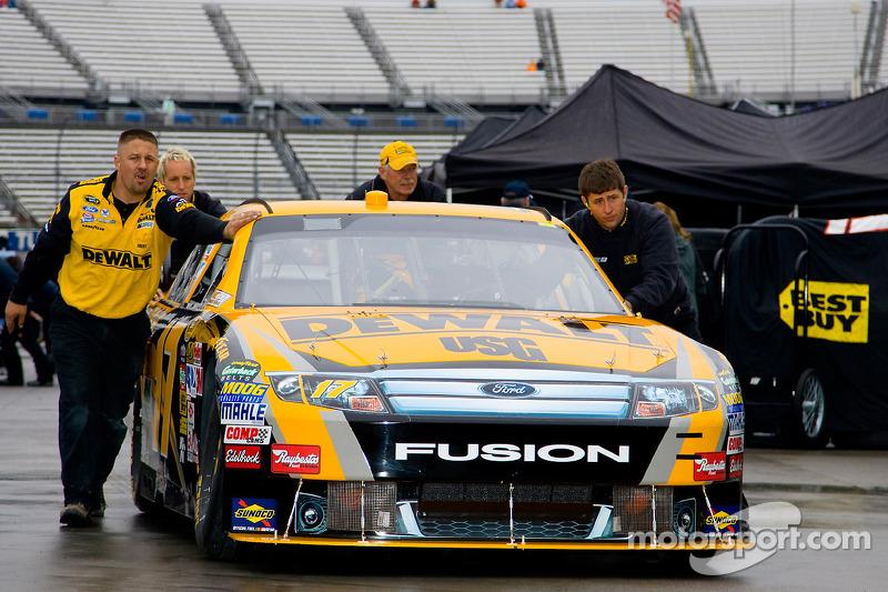 Matt Kenseth's crew push the DeWalt Ford to it's garage stall