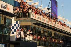 Podium: race winner Jenson Button, Brawn GP, second place Rubens Barrichello, Brawn GP, third place