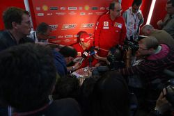 Kimi Raikkonen, Scuderia Ferrari, talks with the media after the race