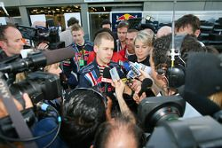 Sebastian Vettel, Red Bull Racing, talks with the media after the race