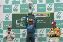 Diego Nunes celebrates his victory on the podium with Kamui Kobayashi and James Jakes