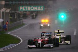 Jarno Trulli, Toyota F1 Team and Rubens Barrichello, Brawn GP