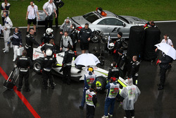 Jenson Button, Brawn GP, reformed grid, after race was red flagged due to rain