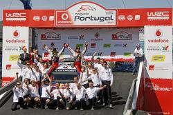 Podium: winners Sébastien Loeb and Daniel Elena celebrate with Citroen Total World Rally Team