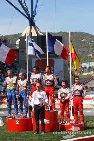 Podium: winners Sébastien Loeb and Daniel Elena, second place Mikko Hirvonen and Jarmo Lehtinen, thi