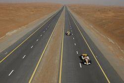 Romain Grosjean and Adam Khan drive the Renault F1 R28 cars down a Dubai highway