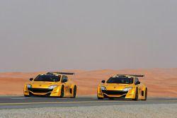 Romain Grosjean and Adam Khan drive the Renault cars down a Dubai highway