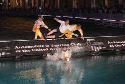 Nelson A. Piquet and Romain Grosjean jump in the water