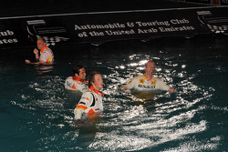 Nelson A. Piquet and Romain Grosjean in the water