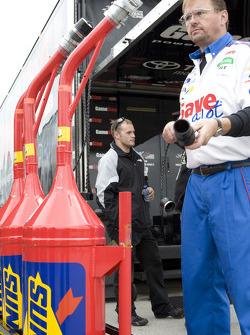 Save a Lot Ford crew member prepares fuel tanks