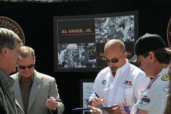 Al Unser Jr. and Bobby Rahal sign autographs