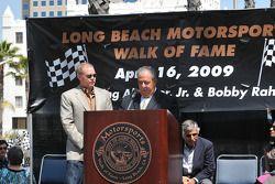 Al Unser Jr. on the podium with mayor Bob Foster