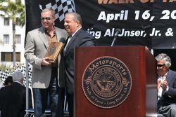 Al Unser Jr. recieves his plaque for Mayor Bob Foster