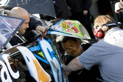 Carl Edwards crew goes to work on the Aflac Ford after Edwards makes contact with the wall