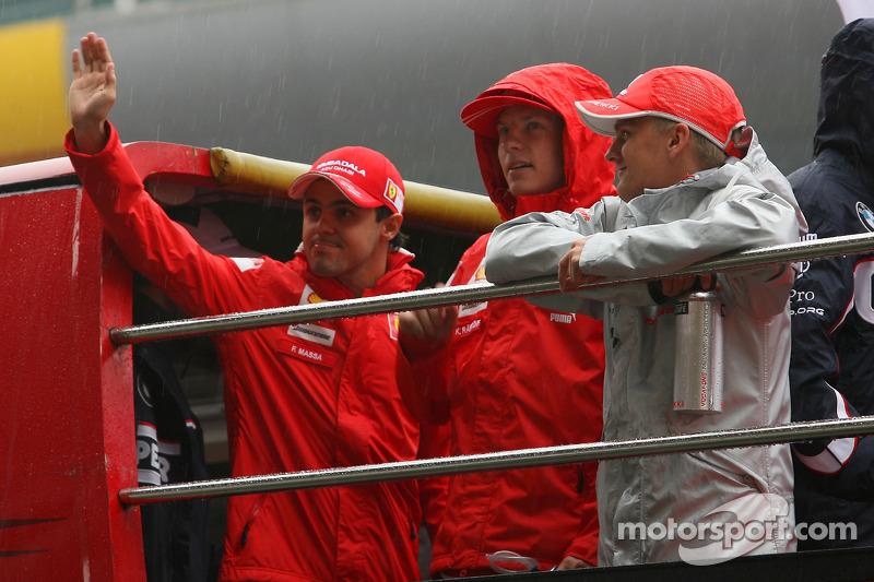 Felipe Massa, Scuderia Ferrari, Kimi Raikkonen, Scuderia Ferrari, e Heikki Kovalainen, McLaren Mercedes