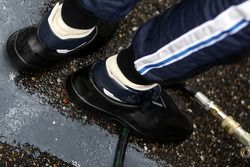 Sebastian Vettel, Red Bull Racing with special covers for his shoes to keep the racing shoes dry
