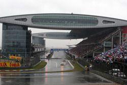 The safety car leads Sebastian Vettel, Red Bull Racing
