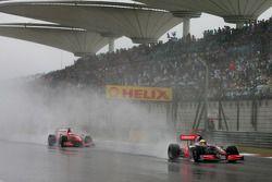Lewis Hamilton, McLaren Mercedes y Kimi Raikkonen, Scuderia Ferrari