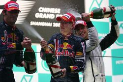 Podium: champagne for race winner Sebastian Vettel, Red Bull Racing, second place Mark Webber, Red B