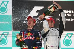 Podium: champagne for race winner Sebastian Vettel, Red Bull Racing, third place Jenson Button, Braw