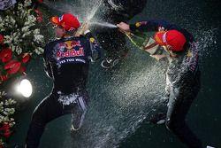 Podium: champagne for race winner Sebastian Vettel, Red Bull Racing, second place Mark Webber, Red B