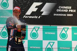 Podium: champagne for race winner Sebastian Vettel, Red Bull Racing