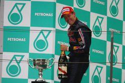 Podium: champagne for race winner Sebastian Vettel, Red Bull Racing
