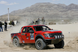 Greg Biffle drives a Ford F-150 SVT Raptor R truck at a desert race course, part of the Terrible's 250 Best in the Desert Racing Association event