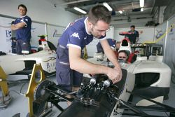 A Barwa International Campos Grand Prix mechanic at work
