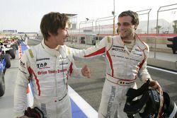 Kamui Kobayashi celebrates his pole position with team mate Jerome D'Ambrosio