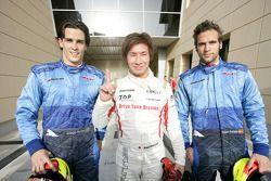 Kamui Kobayashi celebrates his pole position with Diego Nunes and Roldan Rodriguez