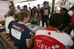 Hamad Al Fardan, Vitaly Petrov, Kamui Kobayashi and Davide Valsecchi sign autographs for the fans