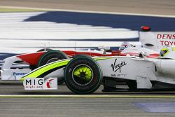 Рубенс Баррикелло, Brawn GP, и Ярно Трулли, Toyota F1 Team