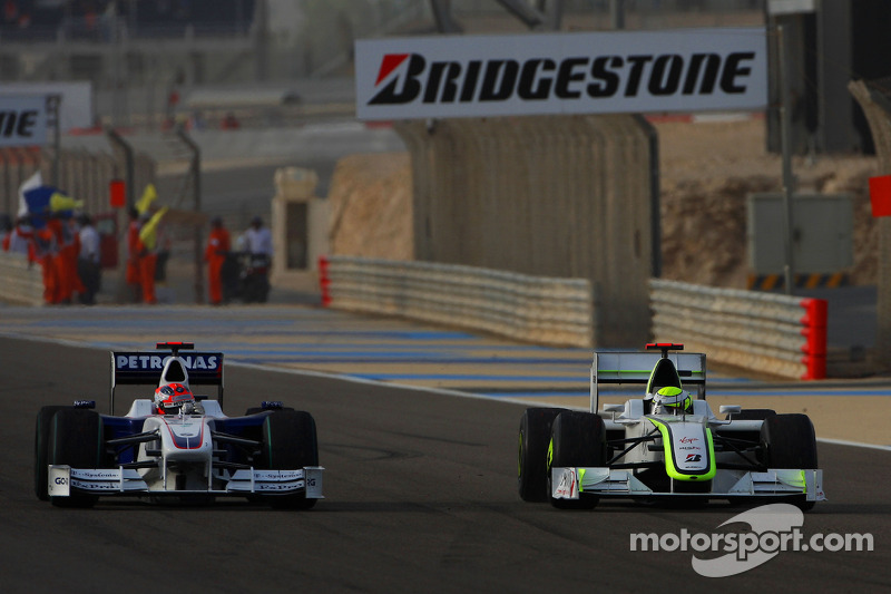 Jenson Button, Brawn GP y Robert Kubica, BMW Sauber F1 Team